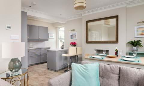 Open plan lounge with alexa, smart tv, log burner,