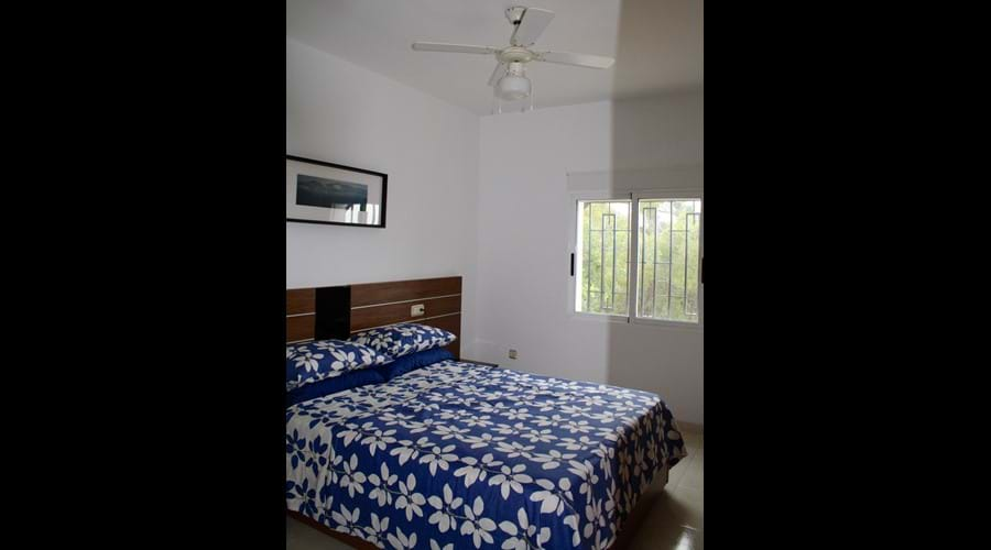 Master Bedroom with both air con and a ceiling fan