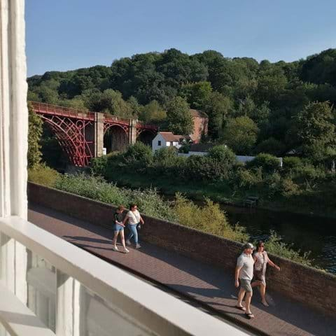 Relax in the armchair and enjoy the stunning view of the Iron Bridge