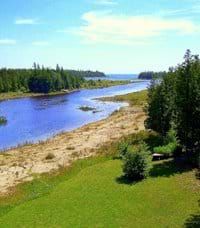 Sandy apron along water's edge and the shallow water in front of cottage is perfect for young children.