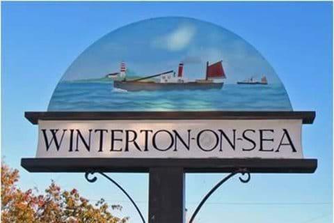 Winterton-on-Sea village sign