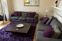 Ground Floor Sitting Room with Large Smart TV, DVD, coffee table and 2 large sofas and 2 tub leather chairs