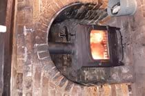 Log and coal burning stove in the lounge