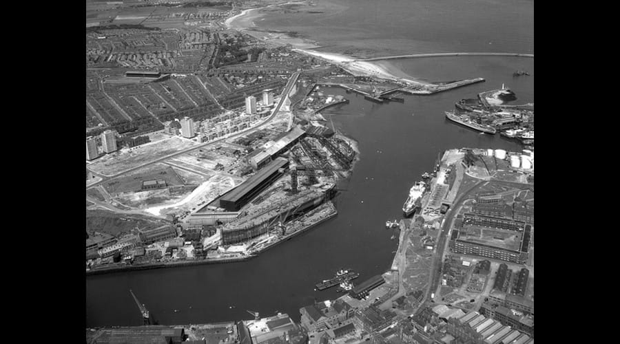 Aerial view of the North Sands shipyard of J.L. Thompson & Sons Ltd, Sunderland, July 1964 (TWAM ref. DT.TUR/2/34170). The image also gives a great view of the surrounding area, including the football stadium, Roker Park.