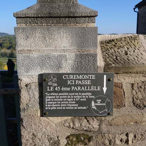 Curemonte 45th parallel line sign to indicate it flows through the village