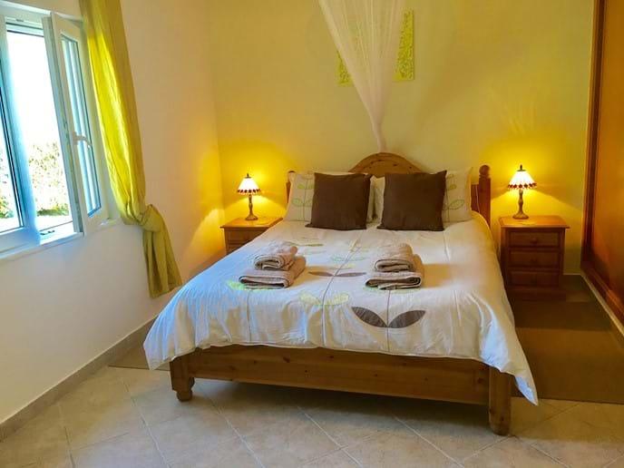 Bedroom 1 with ensuite, king size bed, sliding wardrobes, lights on