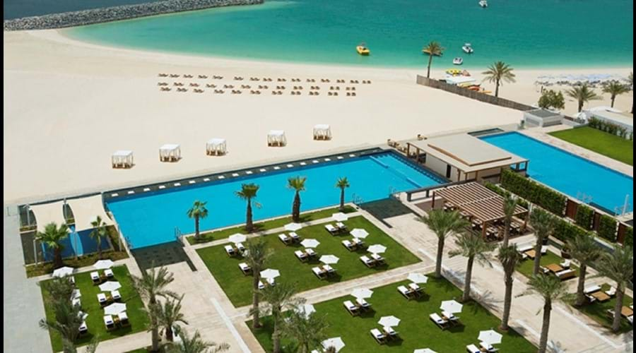 Welcome to Dubai - View of Al Bateen pool area and beach to the right Hilton Hotel pool area on left