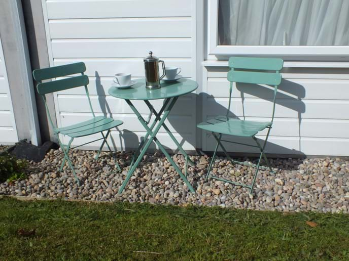 Outside table and chairs catches the morning sun