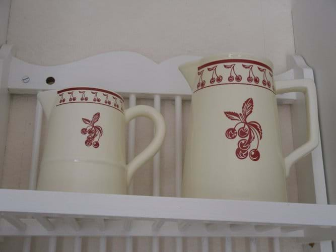 two pretty china jugs on display in the kitchen
