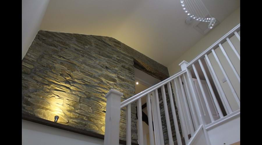 The original apple barn feature wall to stairs