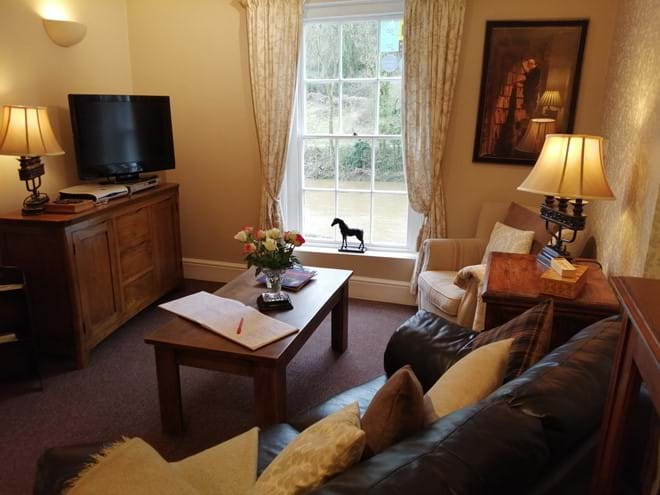 Lovely cosy lounge - overlooking the River Severn and the Iron Bridge