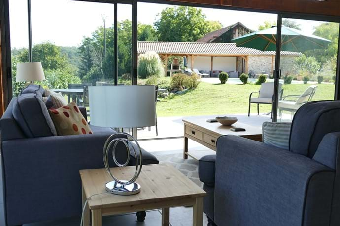The Le Noyer sitting room overlooks the pool and garden