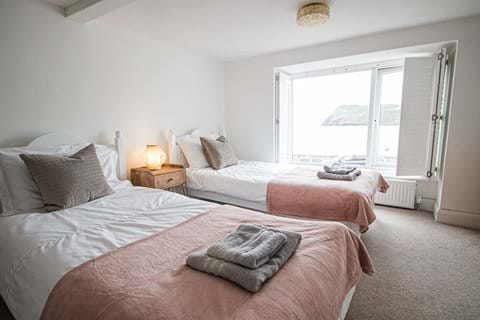 Twin bedroom with two singles and a seaview