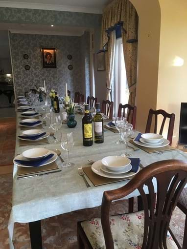 photo showing dining room with table set for 20 people