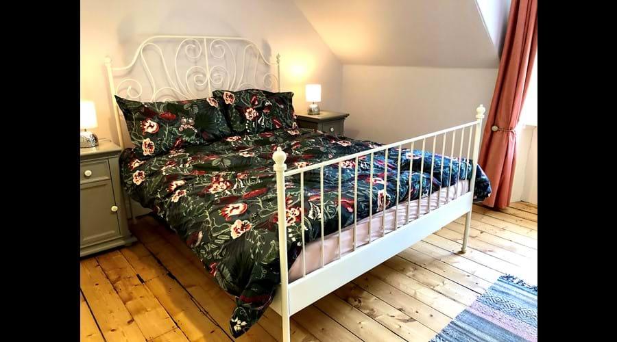En-suite queen bedroom upstairs.