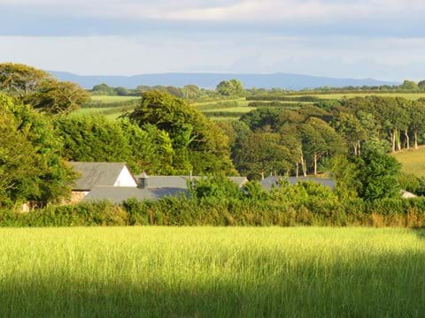 Gallery Cottages nestled in the countryside with Dartmoor in the distance