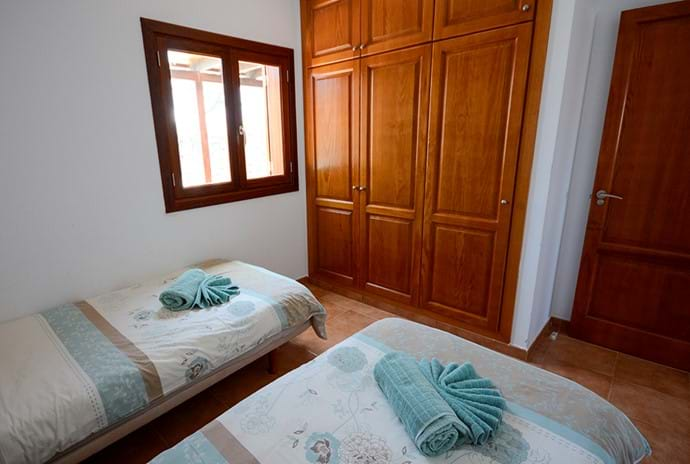 Bedroom 2 - twin or kingsize - you choose. Storage and window to Patio
