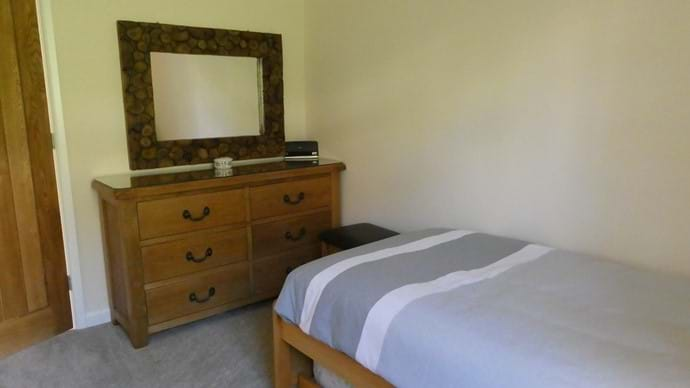 Large chest of drawers in the single room which can be set up as a twin room