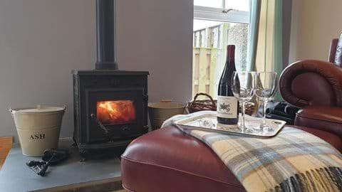 Wood-burning stove in both Stewards & Hayloft House