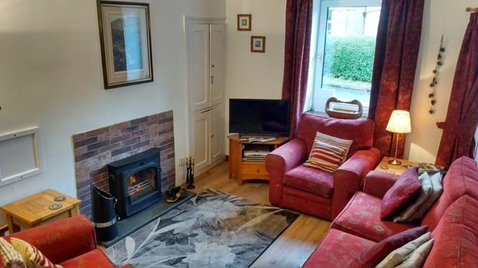 The comfortable lounge at Stybarrow Cottage