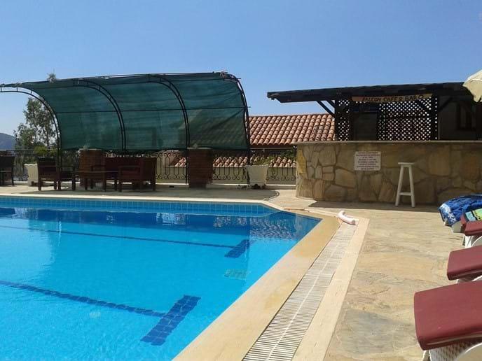 Plenty of sunbathing and alfresco dining space round the huge pool