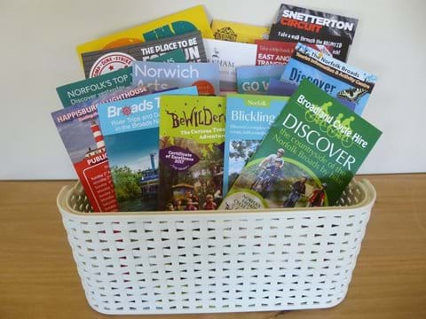 A basket full of leaflets and brochures on the surrounding area