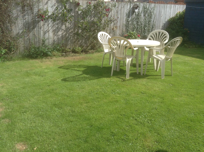 The back garden is fenced.