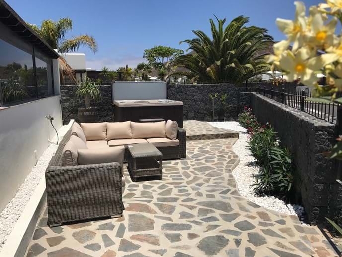 Second terrace with hot tub and cosy seating area
