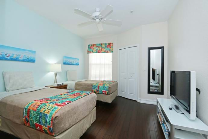 newly refurbished Bedroom 2 at 7-108 with walk in closet, TV, A/C, ceiling fan