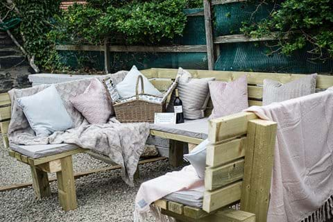 Garden with handmade furniture, cushions provided, bbq and beach view