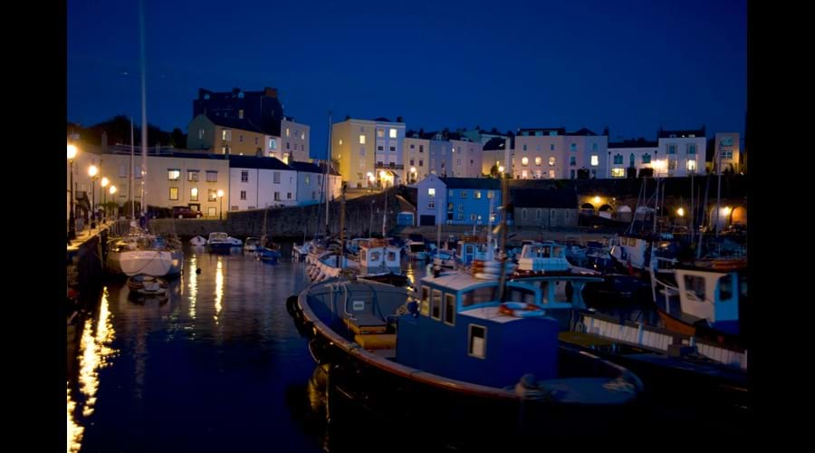 Harbour & cottage at night