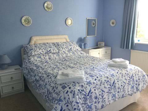 Large Kingsize Bedroom 1 - with full vanity basin unit & double wardrobe.