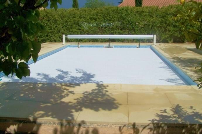 The heated swimming pool - with powered security cover closed