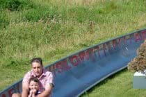 Pembrey Country park, Superb 7 mile beach, loads of parking and picnic areas plus a dry ski slope and toboggan run.