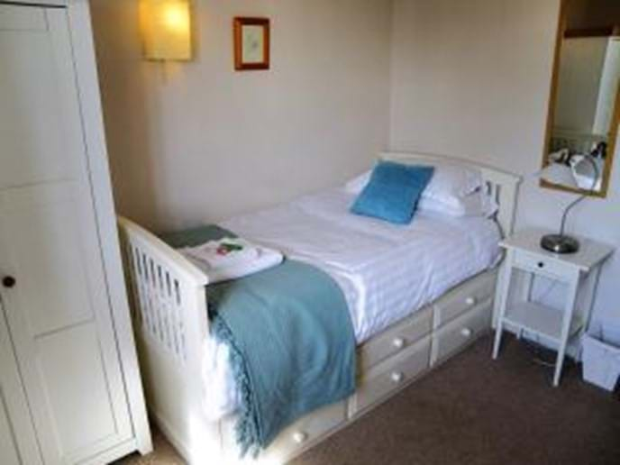 The fourth bedroom - with optional second full size single bed for groups of eight guests