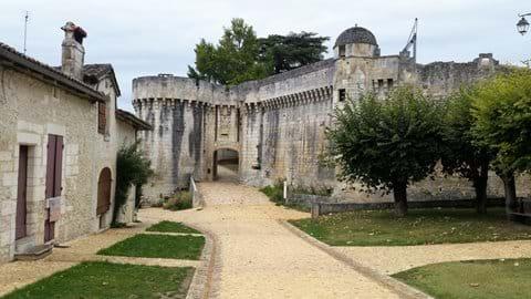 Pale beige stone entrance to chateau Bourdeilles