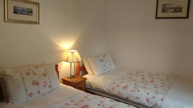 The twin bedroom with views of Glenridding Dodd and Sheffield Pike