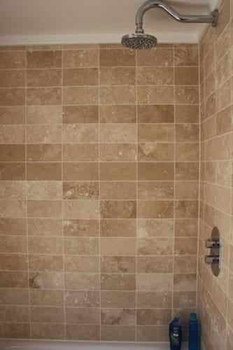 Mixer shower above bath in family bathroom