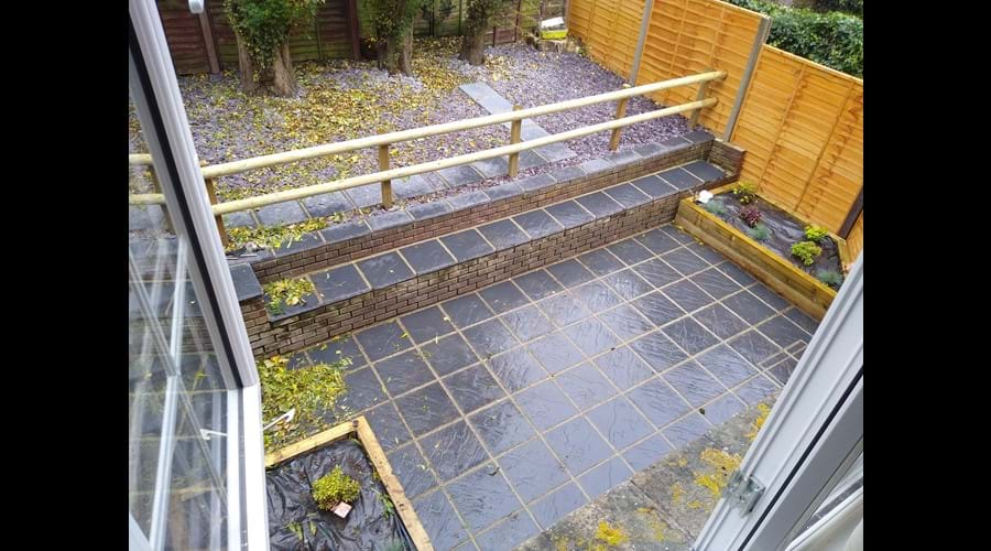 Enclosed terraced garden - it does have table and chairs now!