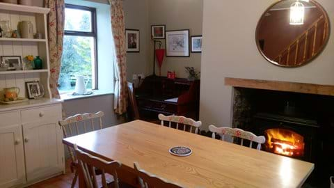 Relax in the dining room with the warm glow of a blazing stove while you enjoy the unhuried pace of country life.