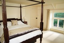 Four poster bed in the Master bedroom