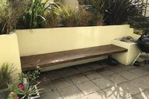 Lower Section of Patio Garden with Bench Seating and Barbecue