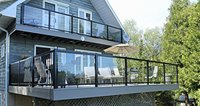 Re-modelled front deck in 2014 now with PVC and glass railings for better viewing of the spectacular scenery