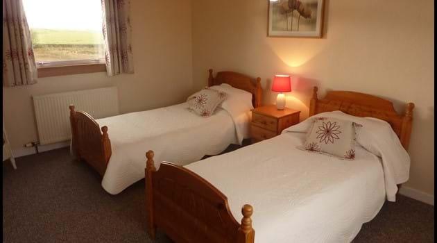 Spacious twin bedroom upstairs.