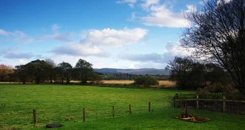 View from garden over fields and Cambrian Mountains beyond
