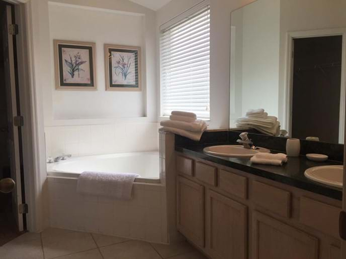 Master Ensuite Bath with Door Access to Closet