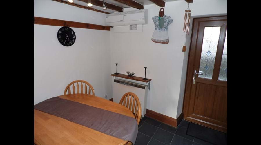 Dining kitchen with access to rear patio