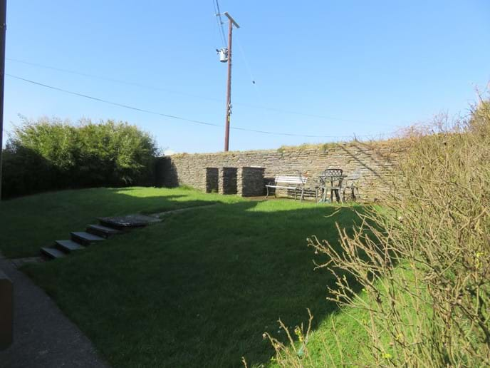 Sheltered back garden and BBQ area