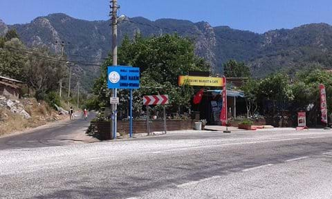 """This is where you turn, into the village road, off the main road. Note the blue """"INCI NARIN"""" sign as described."""