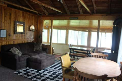 Dining area and living room area with view of porch.